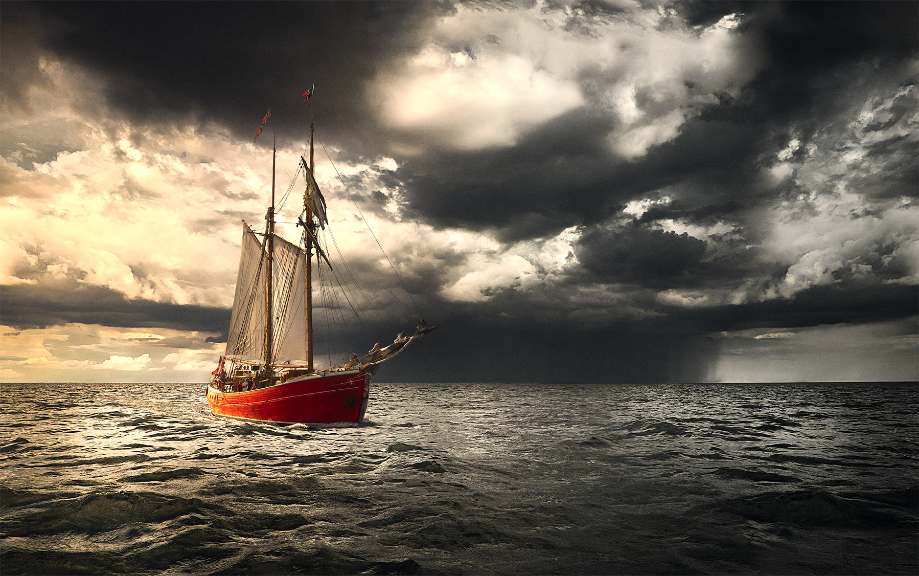 """Storm is Coming"" seascape photography of a Red ship near a storm"
